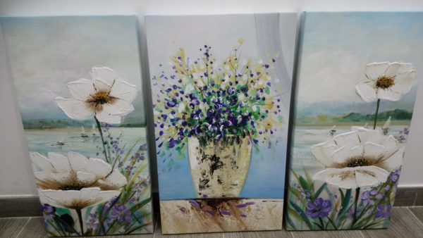 quadri con vaso di fiori e paesaggio